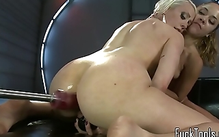 Sybian riding babe drilled by machine