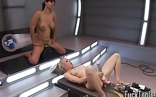 Bound lesbos getting machine fucked