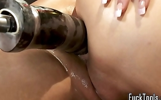 Busty machine milf gets her holes dildoed
