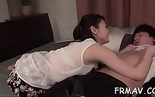 Lascivious oriental toys own snatch while giving wet blowjob
