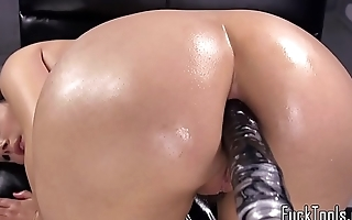 Busty machine beauty enjoys anal play