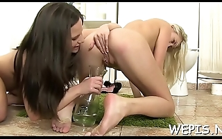 Wild sluts are pissing on bald vaginas of each other