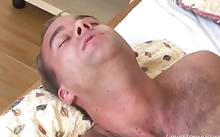 Guy Sucks on a Strapon and Receives Pleasure