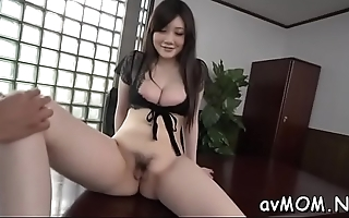 Moaning asian milf with sextoy pampers her fat pussy making it wet