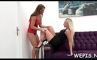One babe is pissing while the other one is licking her vagina