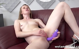 Slender chick toys bald pussy till achieving orgasm