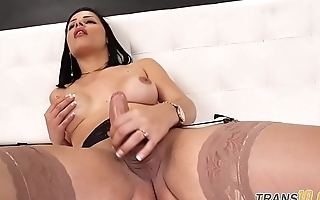 Solo trans babe wanking in sexy stockings
