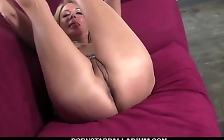 Meaty cougar playing with sex toys