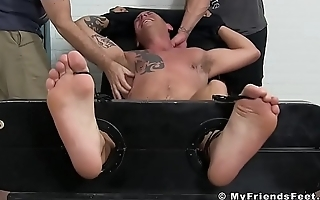 Tied up hunk tickled by his feet loving mature friends
